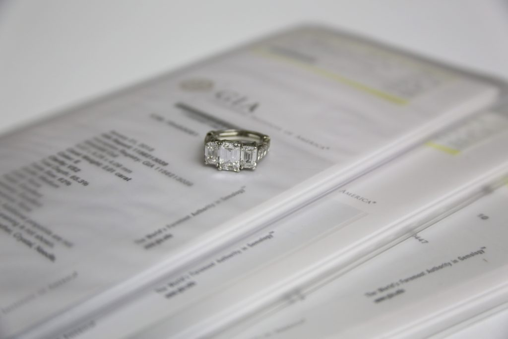 This ring's value significantly increases because it has a GIA certification for each of its three stones.