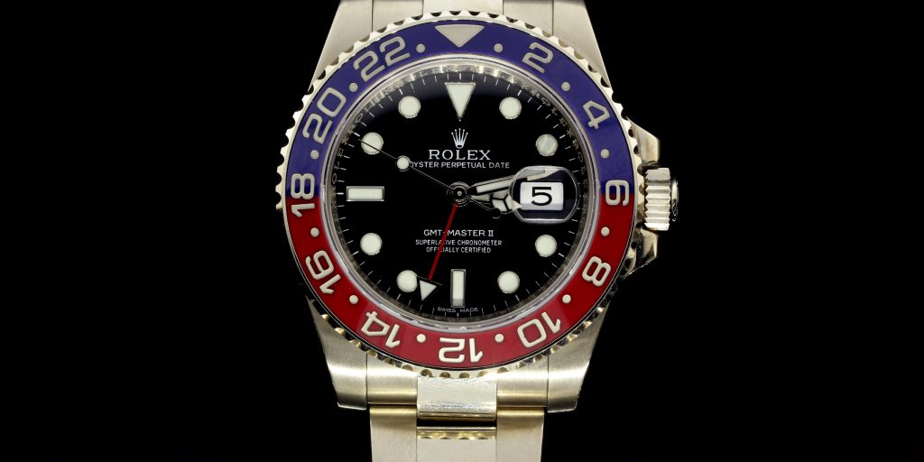 Rolex GMT Master II in 14k White Gold.