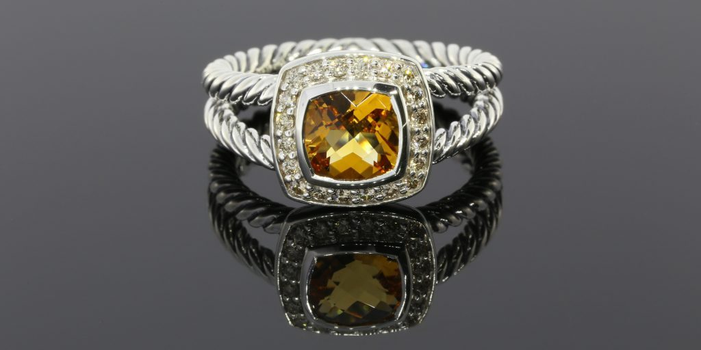 This is a beautiful David Yurman Citrine and Diamond Cable Ring from the Petite Albian collection that we bought for $210.