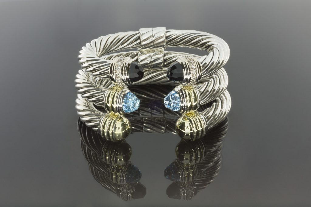David Yurman sterling silver cable bracelets.